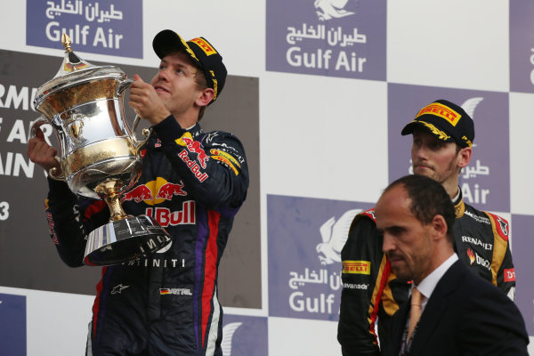 Bahrain International Circuit, Sakhir, Bahrain Sunday 21st April 2013 Sebastian Vettel, Red Bull Racing, 1st position, lifts his trophy. World Copyright: Andy Hone/LAT Photographic ref: Digital Image HONZ3035