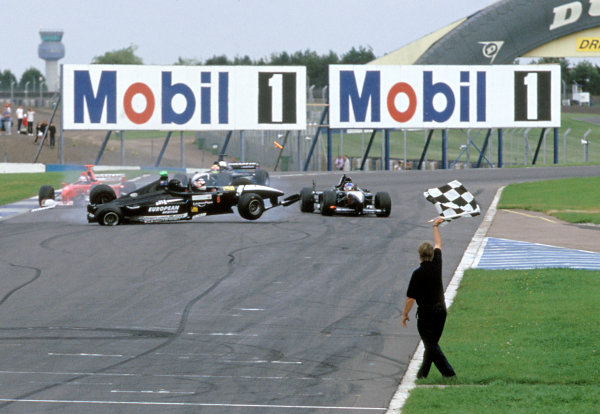 2001 Minardi F1 Two Seater Race.Donington, England. 21st August 2001.Nigel Mansell crashes into Fernando Alonso at the end of the world's first two seater race.World Copyright: Peter Spinney/LAT Photographicref: 35mm Image A10