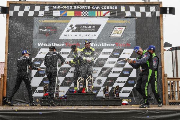 #35 Riley Motorsports Mercedes-AMG, GS: James Cox, Dylan Murry, #7 Park Place Motorsports Porsche Cayman GT4 MR, GS: Alan Brynjolfsson, Trent Hindman, #39 Carbahn Motorsports Audi R8, GS: Tyler McQuarrie, Jeff Westphal, podium, champagne