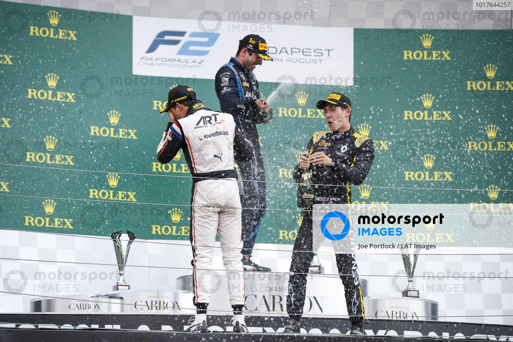 HUNGARORING, HUNGARY - AUGUST 03: Race winner Nicholas Latifi (CAN, DAMS) celebrates on the podium with the champagne and Nyck De Vries (NLD, ART GRAND PRIX) and Jack Aitken (GBR, CAMPOS RACING) during the Hungaroring at Hungaroring on August 03, 2019 in Hungaroring, Hungary. (Photo by Joe Portlock / LAT Images / FIA F2 Championship)
