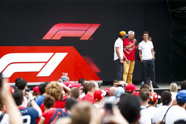 Carlos Sainz Jr, McLaren and Lando Norris, McLaren on stage in the fan zone