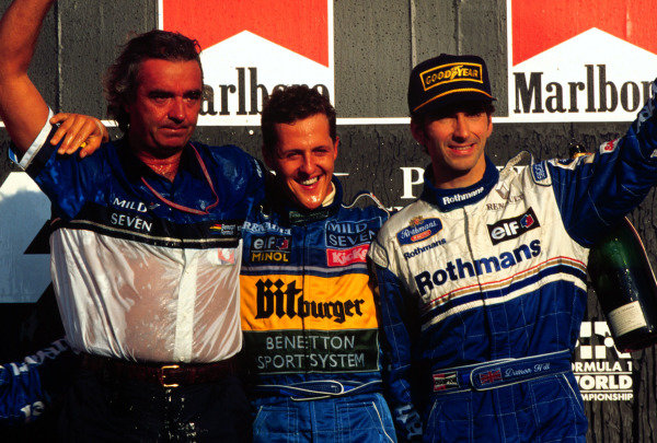 1995 Pacific Grand Prix.Tanaka International, Aida, Japan.20-22 October 1995.Michael Schumacher (Benetton Renault) celebrates with team principal Flavio Briatore and Damon Hill (Williams Renault) after winning and thus clinching his second World Championship.World Copyright - LAT Photographic