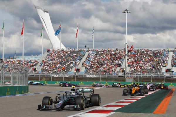 Carlos Sainz Jr., McLaren MCL34, leads Valtteri Bottas, Mercedes AMG W10, Lando Norris, McLaren MCL34, Sergio Perez, Racing Point RP19, Max Verstappen, Red Bull Racing RB15, Nico Hulkenberg, Renault R.S. 19, as behind, Antonio Giovinazzi, Alfa Romeo Racing C38, Romain Grosjean, Haas VF-19 and Daniel Ricciardo, Renault R.S.19 collide