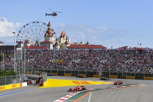 Sebastian Vettel, Ferrari SF90, leads Charles Leclerc, Ferrari SF90 Lewis Hamilton, Mercedes AMG F1 W10, Carlos Sainz Jr., McLaren MCL34, Valtteri Bottas, Mercedes AMG W10, Lando Norris, McLaren MCL34 and the rest of the pack at the start
