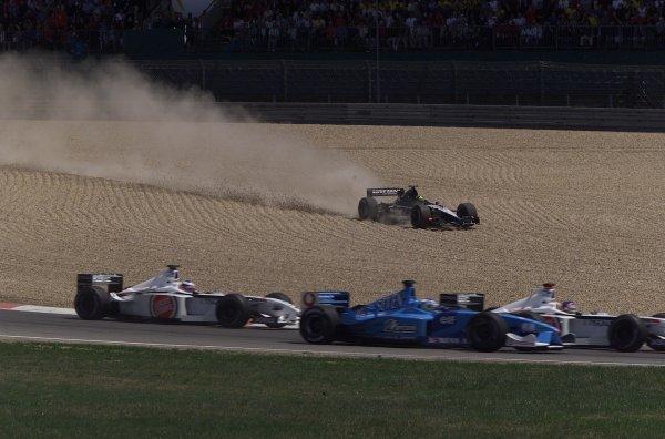 2001 European Grand Prix. RACENurburgring, Germany. 24th June 2001A European Minardi runs wide at the start of the race.World Copyright - LAT Photographicref: 8 9 MB Digital File Only