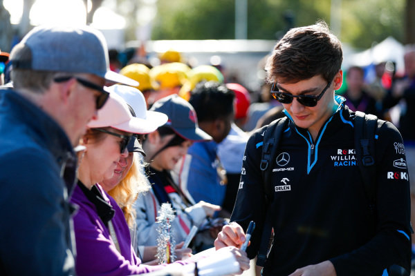 George Russell, Williams Racing, signs autographs for fans
