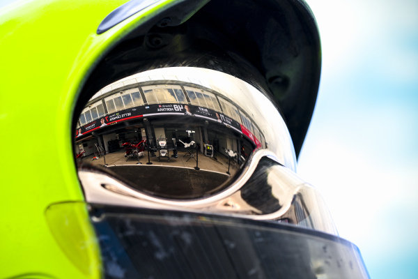 The Venturi garage reflected in a fire marshals visor