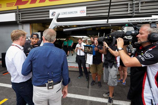 Spa-Francorchamps, Spa, Belgium. Sunday 23 August 2015. Lewis Hamilton, Mercedes AMG talks to Simon Lazenby and Martin Brundle of Sky Sports F1. World Copyright: Steve Etherington/LAT Photographic ref: Digital Image SNE22788