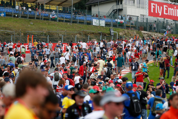Spa-Francorchamps, Spa, Belgium. Sunday 23 August 2015. Fans invade the circuit after the race. World Copyright: Zak Mauger/LAT Photographic. ref: Digital Image _L0U5497
