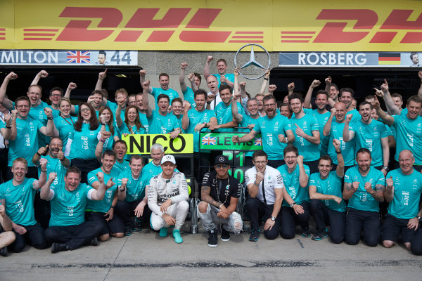 Circuit Gilles Villeneuve, Montreal, Canada. Sunday 7 June 2015. Nico Rosberg, Mercedes AMG, 2nd Position, Lewis Hamilton, Mercedes AMG, 1st Position, and the Mercedes team celebrate a perfect weekend. World Copyright: Steve Etherington/LAT Photographic. ref: Digital Image SNE11525