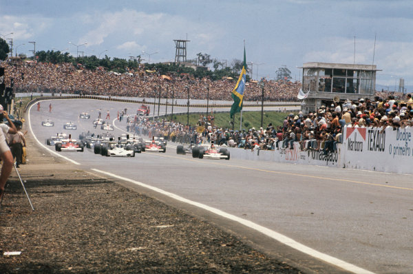 1974 Brazilian Grand Prix  Interlagos, Sao Paulo, Brazil. 25-27th January 1974.  Carlos Reutemann, Brabham BT44 Ford, and Emerson Fittipaldi, McLaren M23 Ford, lead off the front row of the grid at the start.  Ref: 74BRA03. World Copyright: LAT Photographic