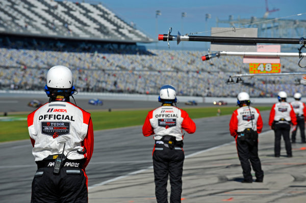 2014 TUDOR United Sportscar Championship Rolex 24 Hours Daytona 23-26 January, 2014, Daytona Beach, Florida USA IMSA Officials watch over pit lane. ©2014, F. Peirce Williams LAT Photo USA