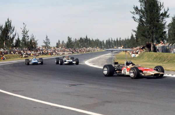 Mexico City, Mexico.1-3 November 1968.Graham Hill leads Jo Siffert (both Lotus 49B Ford) and Jackie Stewart (Matra MS10 Ford). They finished in 1st, 6th and 7th positions respectively.Ref-35mm 68 MEX 90.World Copyright - LAT Photographic