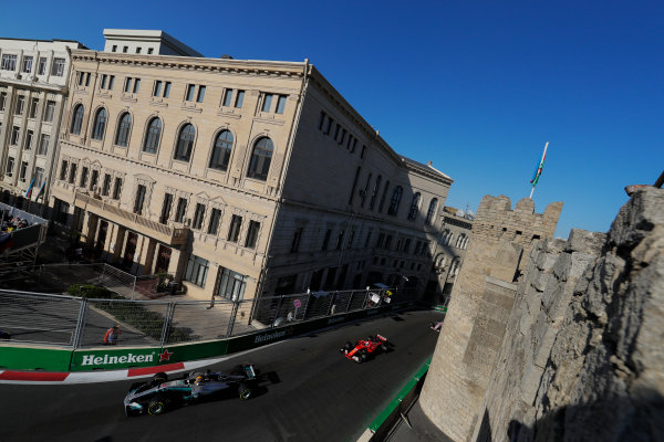 Baku City Circuit, Baku, Azerbaijan. Sunday 25 June 2017. Lewis Hamilton, Mercedes F1 W08 EQ Power+, leads Sebastian Vettel, Ferrari SF70H. World Copyright: Zak Mauger/LAT Images ref: Digital Image _54I4314