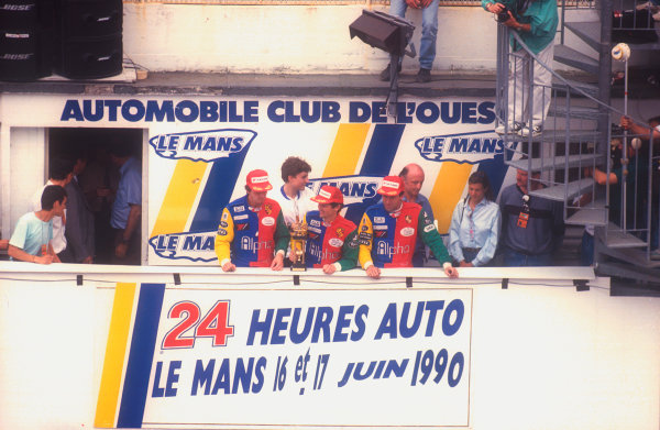 1990 Le Mans 24 Hours. Le Mans, France. 16-17 June 1990. (L-R) David Sears, Anthony Reid and Tiff Needell. Alpha Racing Team (Porsche). 3rd position on the podium. World Copyright: LAT Photographic. Ref:  90LM02.
