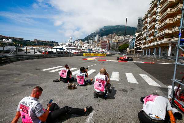 Monte Carlo, Monaco. Thursday 25 May 2017. Sebastian Vettel, Ferrari SF70H, cuts the chicane as he passes some photographers. World Copyright: Andy Hone/LAT Images ref: Digital Image _ONZ8877