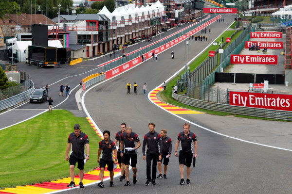 Spa Francorchamps, Belgium.  Thursday 24 August 2017. Romain Grosjean, Haas F1, walks the track with colleagues. World Copyright: Al Staley/LAT Images  ref: Digital Image _X0W0222