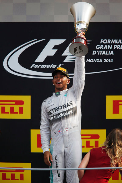 Autodromo Nazionale di Monza, Monza, Italy. Sunday 7 September 2014. Lewis Hamilton, Mercedes AMG, 1st Position, arrives on the podium with his trophy. World Copyright: Charles Coates/LAT Photographic. ref: Digital Image _N7T1155