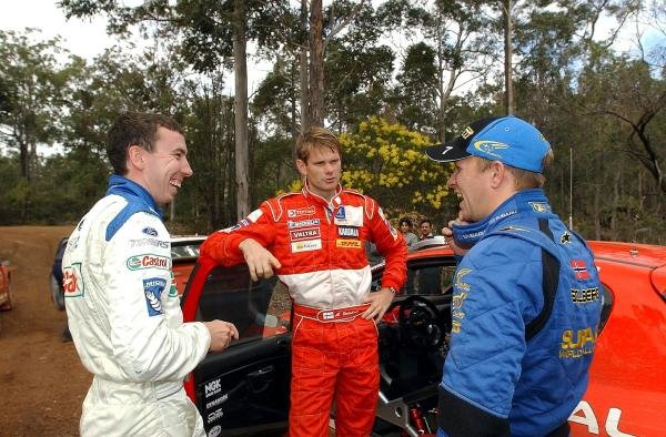 (L to R): Markko Martin (EST) Ford, Marcus Gronholm (FIN) Peugeot and Petter Solberg (NOR) Subaru share a joke before starting stage seven.