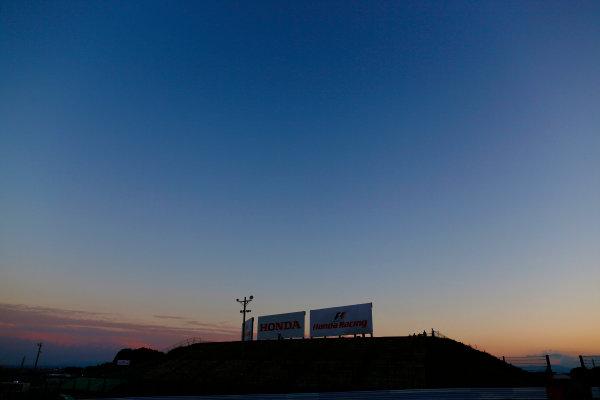Suzuka Circuit, Suzuka, Japan.  Sunday 27 September 2015. The sun falls behind the circuit after the race. World Copyright: Alastair Staley/LAT Photographic ref: Digital Image _R6T2745