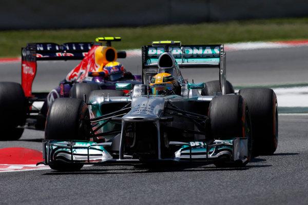 Circuit de Catalunya, Barcelona, Spain 10th May 2013 Lewis Hamilton, Mercedes W04, leads Mark Webber, Red Bull RB9 Renault.  World Copyright: Glenn Dunbar/LAT Photographic ref: Digital Image _89P0878
