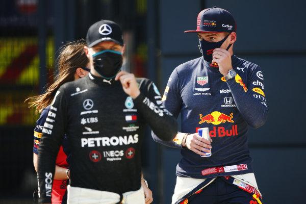 Max Verstappen, Red Bull Racing and Valtteri Bottas, Mercedes-AMG Petronas F1