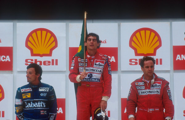 1991 Brazilian Grand Prix.Interlagos, Sao Paulo, Brazil.22-24 March 1991.Ayrton Senna (McLaren Honda) 1st position, Riccardo Patrese (Williams Renault) 2nd position and Gerhard Berger (McLaren Honda) 3rd position on the podium.Ref-91 BRA 06.World Copyright - LAT Photographic