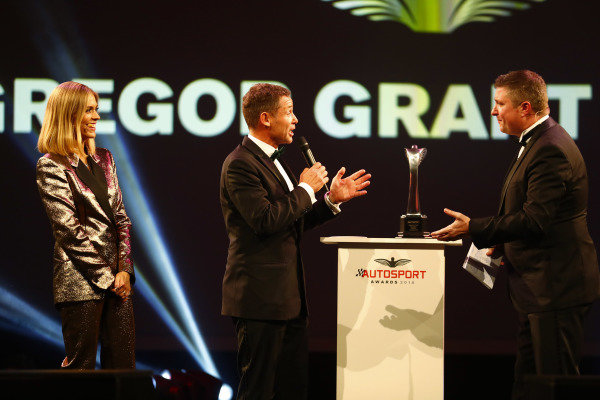 Tom Kristensen on stage to present a Gregor Grant Award