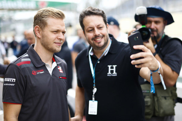 Kevin Magnussen, Haas F1 Team, poses for a picture with a fan.