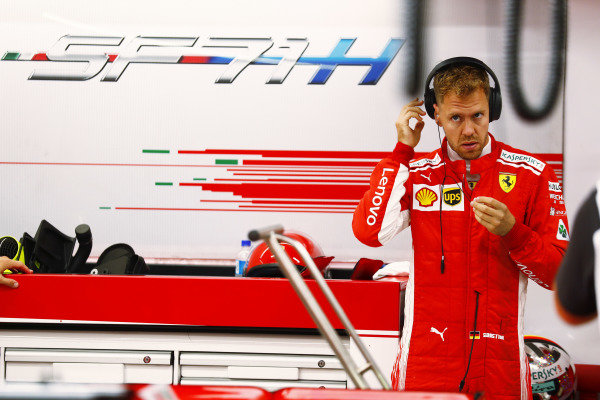 Sebastian Vettel, Ferrari, prepares in the garage