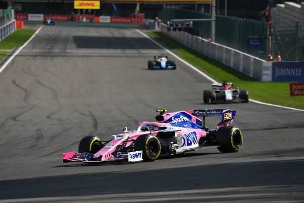 Lance Stroll, Racing Point RP19, leads Kimi Raikkonen, Alfa Romeo Racing C38, and George Russell, Williams Racing FW42