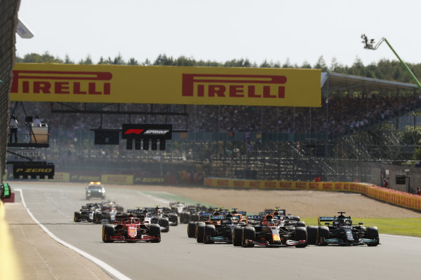 Max Verstappen, Red Bull Racing RB16B, leads Sir Lewis Hamilton, Mercedes W12, Valtteri Bottas, Mercedes W12, Charles Leclerc, Ferrari SF21, and the rest of the field at the start