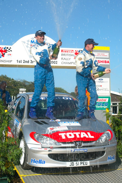 2002 British Rally Championship.Manx International Rally. Douglas, Isle of Man.1-3 August 2002.Justin Dale/Andrew Bargery (Peugeot 206) celebrate their S16 class victory on the podium (6th overall).Ref-02 MIR 31.World Copyright - Malcolm Griffiths/LAT Photographic