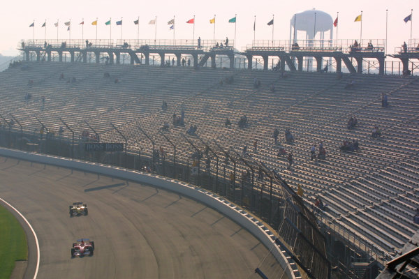 2002 American Grand Prix.Indianapolis, Indiana, USA. 27-29 September 2002.Michael Schumacher (Ferrari F2002) followed by Takuma Sato (Jordan EJ12 Honda).World Copyright - LAT Photographicref: Digital File Only