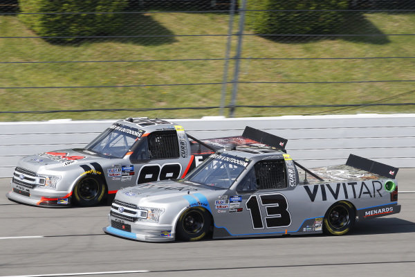 #13: Johnny Sauter, ThorSport Racing, Ford F-150 Tenda and #98: Grant Enfinger, ThorSport Racing, Ford F-150 Protect the Harvest/Curb Records
