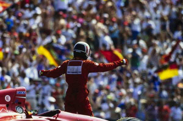 Gerhard Berger, Ferrari 412T1, celebrates victory.