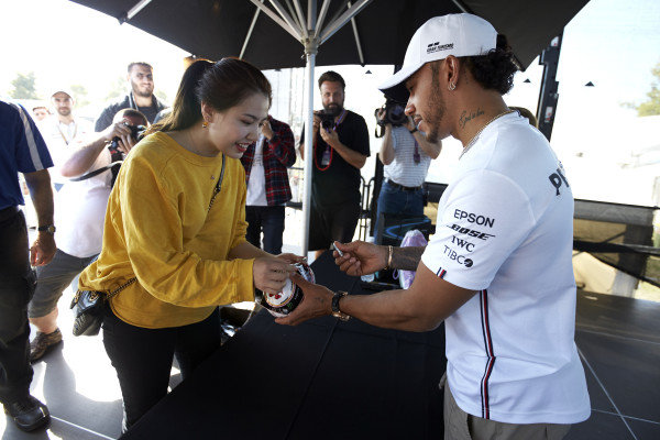 Lewis Hamilton, Mercedes AMG F1 signs autographs for fans
