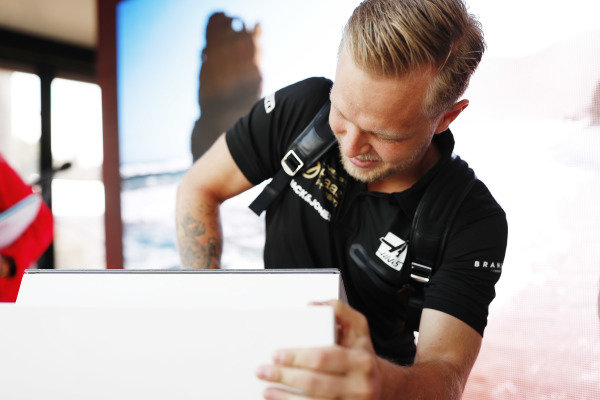 Kevin Magnussen, Haas F1 Team, signs autographs for fans.