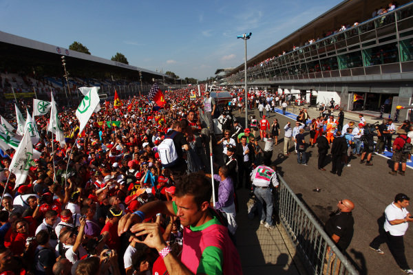 Fans invade the circuit and the pits.