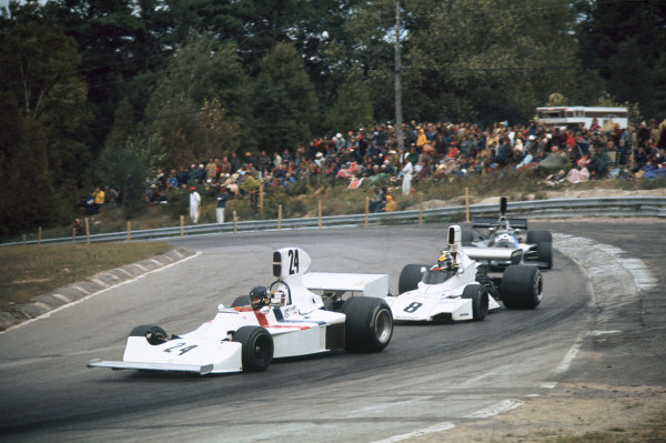 1974 Canadian Grand Prix  Mosport Park, Canada. 22 September 1974.  James Hunt, Hesketh 308 Ford, 4th position, leads Carlos Pace, Brabham BT44 Ford, 8th position.  Ref: 74CAN06. World Copyright: LAT Photographic