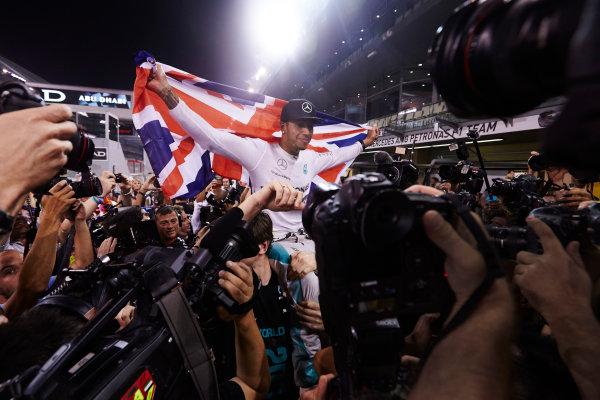 Yas Marina Circuit, Abu Dhabi, United Arab Emirates. Sunday 23 November 2014.  Lewis Hamilton, Mercedes AMG, celebrates championship victory.  World Copyright: Steve Etherington/LAT Photographic. ref: Digital Image SNE13410