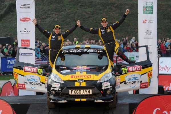 Craig Breen (IRL) and Gareth Roberts (GBR) celebrate the FIA WRC Academy Championship win on the podium in Cardiff Castle.