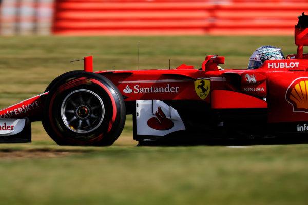 Silverstone, Northamptonshire, UK.  Friday 14 July 2017. Sebastian Vettel, Ferrari SF70H.  World Copyright: Zak Mauger/LAT Images  ref: Digital Image _56I8430
