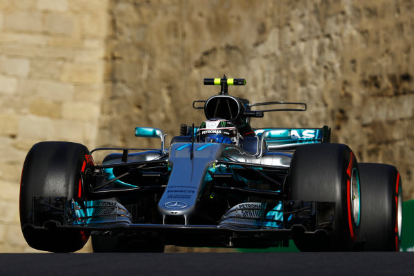 Baku City Circuit, Baku, Azerbaijan. Friday 23 June 2017. Valtteri Bottas, Mercedes F1 W08 EQ Power+, lifts a wheel. World Copyright: Steven Tee/LAT Images ref: Digital Image _O3I1373