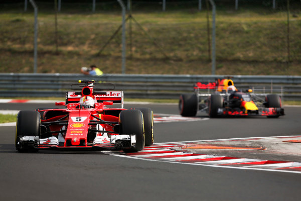 Hungaroring, Budapest, Hungary.  Wednesday 02 August 2017. Sebastian Vettel, Ferrari SF70H, leads Pierre Gasly, Red Bull Racing RB13 TAG Heuer. World Copyright: Joe Portlock/LAT Images  ref: Digital Image _L5R1957