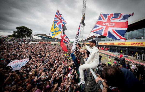Silverstone, Northamptonshire, UK.  Sunday 16 July 2017. Lewis Hamilton, Mercedes AMG, 1st Position, celebrates victory with the British fans. World Copyright: Dunbar/LAT Images  ref: Digital Image _X4I8571