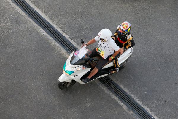 Yas Marina Circuit, Abu Dhabi, United Arab Emirates. Sunday 29 November 2015. Pastor Maldonado, Lotus F1, gets a lift back to his garage. World Copyright: Jed Leicester/LAT Photographic ref: Digital Image _L1_2125