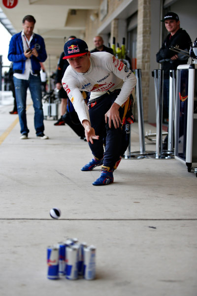 Circuit of the Americas, Austin, Texas, United States of America. Saturday 24 October 2015. Max Verstappen, Toro Rosso, plays skittles in the pit lane. World Copyright: Glenn Dunbar/LAT Photographic. ref: Digital Image _89P4859