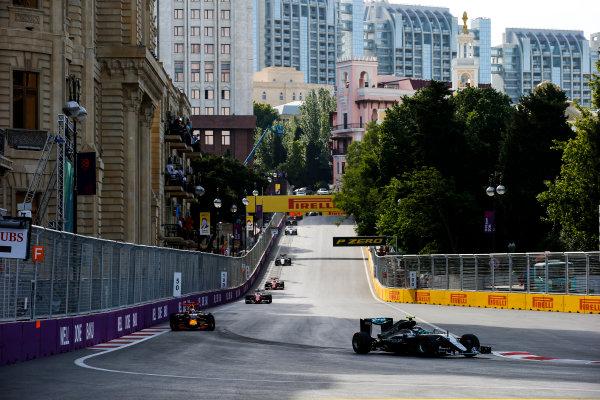 Baku City Circuit, Baku, Azerbaijan. Sunday 19 June 2016. Nico Rosberg, Mercedes F1 W07 Hybrid leads Daniel Ricciardo, Red Bull Racing RB12 TAG Heuer & Sebastian Vettel, Ferrari SF16-H, at the start of the race World Copyright: Sam Bloxham/LAT Photographic ref: Digital Image _SLA3477