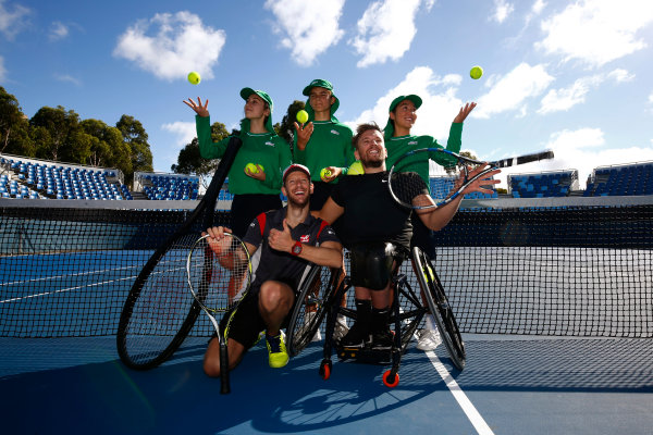 Albert Park, Melbourne, Australia. Thursday 23 March 2017. Romain Grosjean, Haas F1, poses for a photo with Australian Paralympic tennis champion Dylan Alcott and ball boy and girls. World Copyright: Andy Hone/LAT Images ref: Digital Image _ONZ1547
